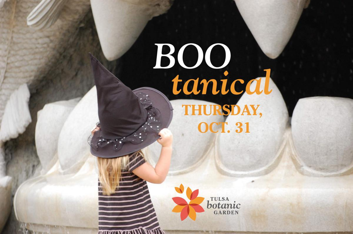 Boo-tanical girl in witch hat in Children's Discovery Garden